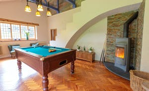 The Benches - The main hall, with fabulous architecture, parquet flooring, a pool table and a wood burning stove