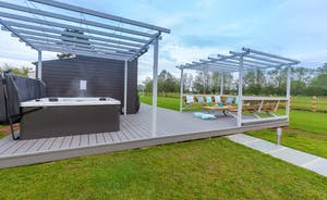 Frog Street: On the veranda there's a hot tub and a seating area, with views over the fields