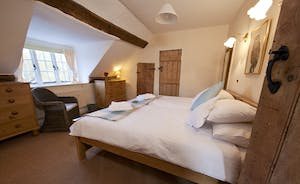 Halse Water House - Bedroom 2 is a twin room on the first floor;  latch and brace doors and beams add so much charm