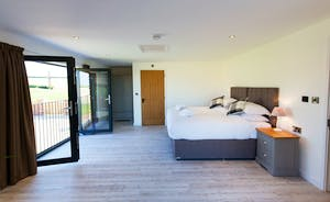 The Granary - Bedroom 2 is a large light and airy room, with French doors and a Juliette balcony