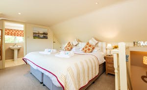 Master en suite bedroom with luxury zip link bed so can be six foot superking or twins