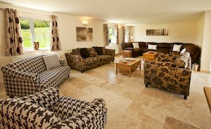 Holemoor Stables - An open plan living space with big comfy sofas to relax upon