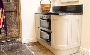 Electric hob with double oven below - an addition to the four oven Aga for even more cooking options!