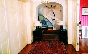 Large Spacious Hallway Leading To The Main Staircase.