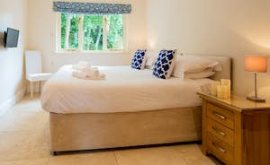 Foxcombe - Dream away in Bedroom 3, a superking or twin room on the ground floor, with an up-to-the-minute en suite shower room that can also be accessed from the hallway
