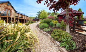 Foxhill Lodge - Landscaped gardens with a pool, play area and BBQ lodge
