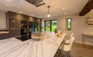 Kinghsay Barton - To one end of the living/entertaining space is a very stylish kitchen