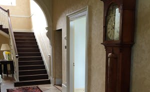 Hallway with antique grandfather clock