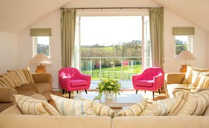 Fuzzy Orchard - With heaps of natural light, the spacious first floor living room has a balcony and far reaching  countryside views