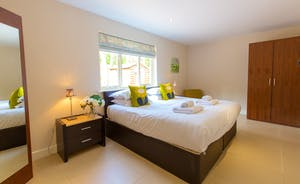 Ramscombe - Bedroom 2 is on the ground floor and has an en suite bathroom with over head shower