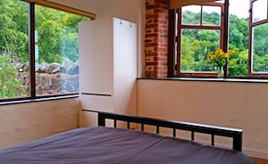 Double bedroom overlooking the summer paddock with view of Wills Neck