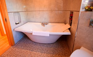 Wayside: The main bathroom has a contemporary free standing bath as well as a separate shower