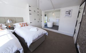 The Benches - Bedroom 2 is a first floor room which can have a superking or twin beds; it has a lovely open plan en suite bathroom with a free standing bath.