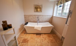 Ilbeare - The shared bathroom has a lovely big bath as well as a shower