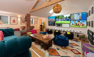 Pigertons - The games room has an immersive TV wall with 7 screens