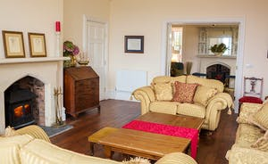 The Old Rectory - Original floorboards, a woodburning stove, period furniture, and relaxing comfy sofas