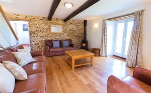 Dippers Rest, Stonehayes Farm - Put your feet up by the warmth of the wood-burner in the living room