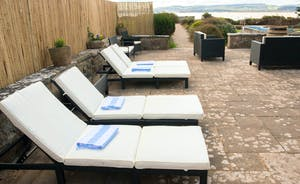 outside sunbeds - table to seat 20
