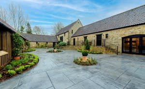 Kingshay Barton - At the front of the house there's a paved courtyard and steps to the main entrance to the house