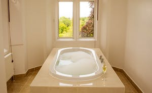 The Old Rectory - The free standing bath in the en suite to the Hellier suite; imagine a bath full of bubbles - and that gorgeous view!