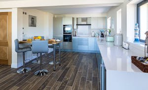 Fully fitted kitchen including breakfast bar and modern appliances