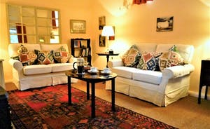 Coachmans Cottage, Steeple Ashton, Wiltshire, BA14 6HH. Comfortable sofas in the sitting room