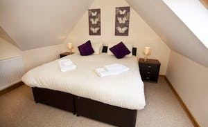 Crowcombe -  Bedroom 5 is the smallest of the bedrooms; comfy and cosy with an en suite shower room