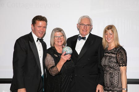 Christine & Alan receiving the Gold Award from Helen Jones of Purple Cloud Consultancy & Phil de Glanville, former Bath Rugby player