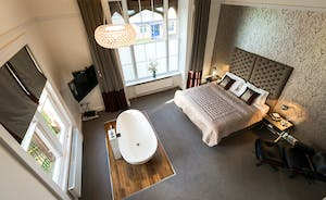 Pitmaston House - The master bedroom with a fabulous free standing bath, en suite shower room and dressing area
