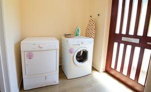 Millgrove House: The utility room has a washer and dryer, and direct access to the garden