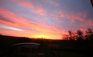 View from Bedroom 2, sunrise over the pool hall