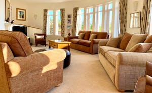 The Cottage Beyond: The sitting room - big windows, gorgeous curved walls