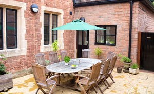 The Old Rectory - Dine outside on the private courtyard patio