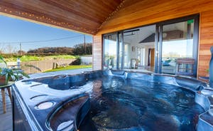 Your private covered Hot Tub just a few steps away