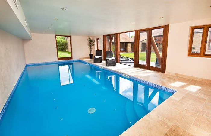 large barn conversion perfect for family holidays and celebrations. Sleeps 18 in 8 en suite rooms with indoor pool and games room