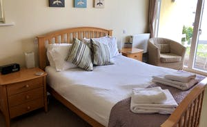 Goose Nest House Master Bedroom overlooking Somerford Lagoon