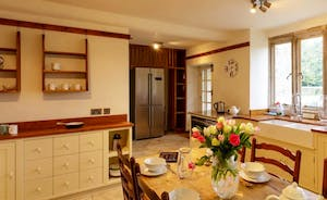 Kitchen with electric oven and hob and Aga in winter