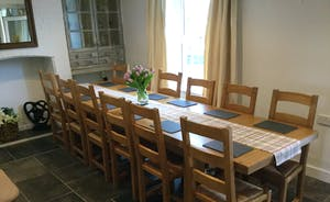 Solid oak dining table in the Reception Room