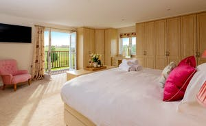 Herons Bank - Bedroom 1: Plenty of wardrobe space, wonderful far reaching views