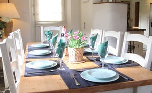 All set for lunch around the farmhouse table