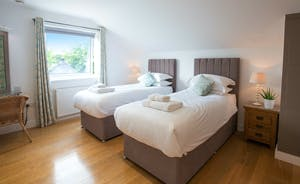 Fuzzy Orchard - Bedroom 5 arranged with twin beds; it has an ensuite bathroom with a separate wet room area