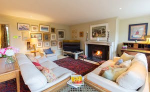 House On The Hill - The more intimate Sitting Room; homely furnishings, and the warmth of an open fire