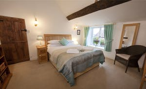 Halse Water House - Bedroom 1 has a kingsize bed and shares the shower room on the ground floor. It has an access door to bedroom 2 if required; this can be a perfect arrangement for families.