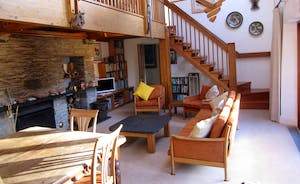 Spacious double-height living room with living and dining areas