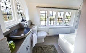 The Benches - The en suite for Bedroom 1; have a soak in the tub and gaze out over the river.