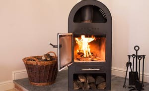 Cockercombe - The heat from the lovely woodburning stove will give you extra warmth on those chilly days (logs supplied)