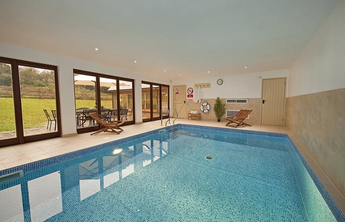 private holiday lodge with own private pool sleeps up to 14 in Somerset