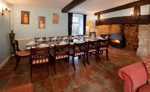 Ilbeare - A refined dining room, with an inglenook fireplace and relaxed seating