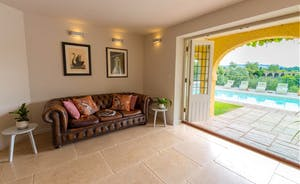 The Benches - Doors open from the kitchen onto a veranda leading to the terrace