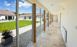 Holemoor Stables: Natural daylight pours in through the floor to ceiling windows